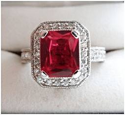 A square cut Red Zircon ring